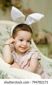 Beautiful girl in Easter Bunny costume white.