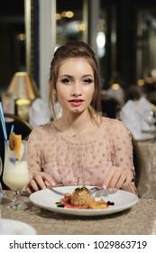 beautiful girl eating in cafe dessert