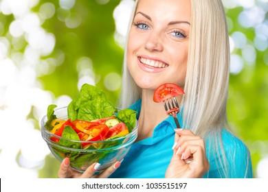 beautiful girl eating a salad