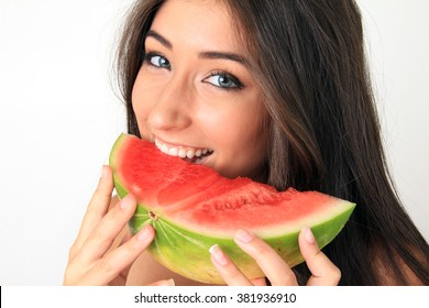Beautiful girl eating a slice of watermelon.