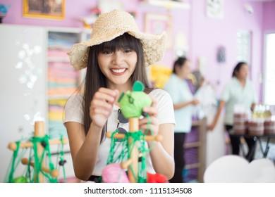 Beautiful girl enjoy her shopping in the souvenir shop