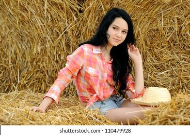 Beautiful girl enjoying the nature in the hay