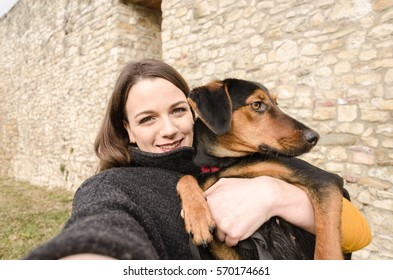 beautiful girl enjoys the time spent with her dog, she loves dog