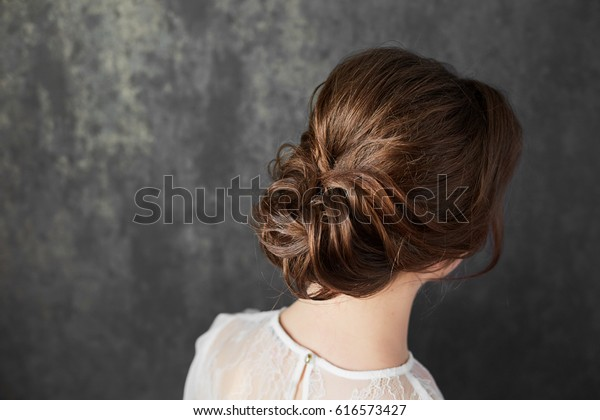 beautiful girl with an evening make-up and hair-style