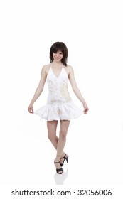 The beautiful girl executing a curtsey on a white background