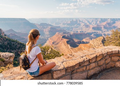 Beautiful girl exploring Grand Canyon national park in Arizona, USA.