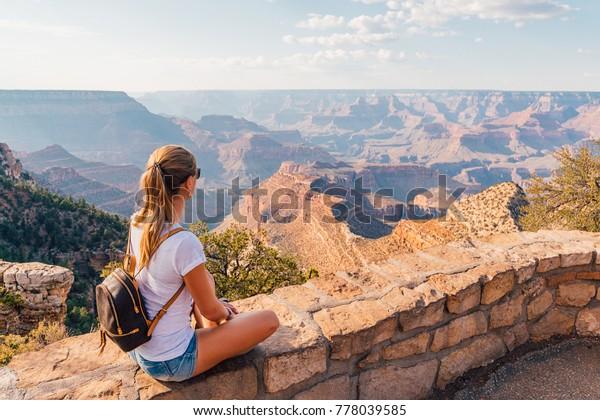 Beautiful girl exploring Grand Canyon national park in Arizona, USA.