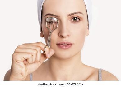 beautiful girl with eyelashes curler