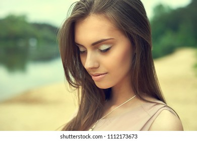 Beautiful girl with eyes closed - close up