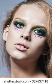 Beautiful Girl face. Perfect skin. Bright makeup