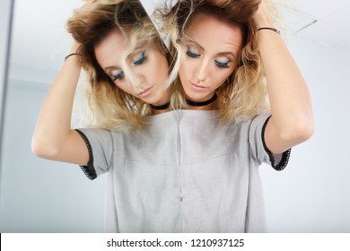 Beautiful Girl in Fashion wear on mirror reflection on white backgrounds, copy space for text logo. illusion, beautiful girl with a mirror in her hands. Reflection of our mind and soul concept.