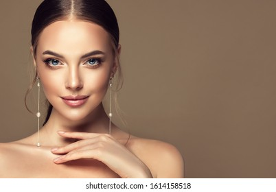 Beautiful girl . Fashionable and stylish woman in trendy jewelry big earrings .  Fashion look  , beauty and style. Natural makeup & easy styling - Shutterstock ID 1614158518