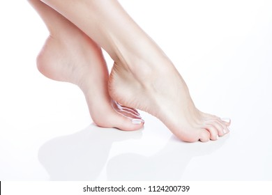 Beautiful girl feet. Legs of ballet dancer. Fresh clean smooth skin and salon nail polish pedicure