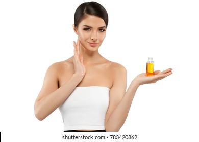 Beautiful girl female with oil cosmetic beauty skin care concept. Young woman model spa with oil skincare