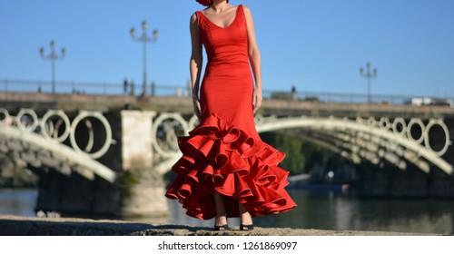 the beautiful girl with the beautiful flamenco red dress