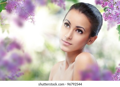 beautiful girl with a flower lilac