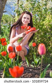 beautiful girl with flowers in garden
