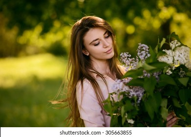 beautiful girl with flowers. outdoor portrait with natural light