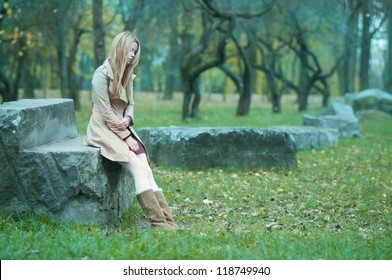 beautiful girl freezing in the park