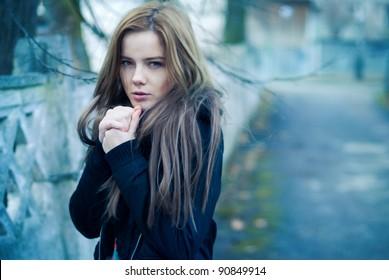 Beautiful girl freezing in the street