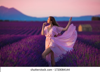 beautiful girl in french lavender fields in Provence with lavender bouquet  smiling emotional background