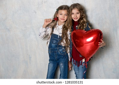 Beautiful girl friends in denim clothing. Fashion. Three girls models in jeans and shirts. Valentine's Day.