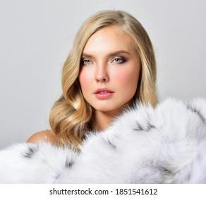 Beautiful girl in a fur coat. Beauty Fashion Model Girl. Luxury Winter Woman.