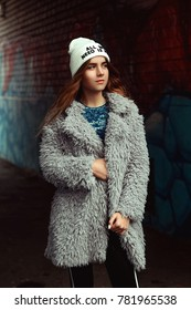 Beautiful girl in a fur coat and hat