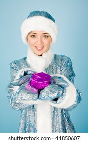 Beautiful girl with gift box  in new year costume
