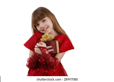 Beautiful girl is giving the gift. Female with present. Attractive lady is holding purple box with gold ribbon. Isolated over white background.