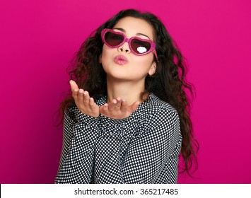 beautiful girl glamour portrait on pink make flying kiss