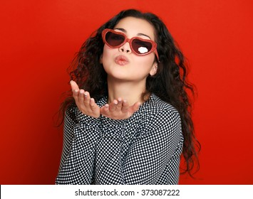 beautiful girl glamour portrait on red make flying kiss
