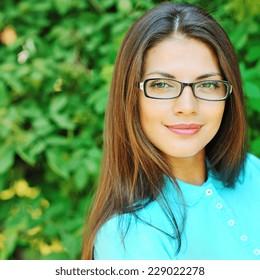 Beautiful girl in glasses - close up