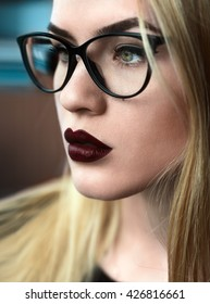 beautiful girl with glasses and dark lips