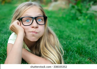 Beautiful girl in the glasses have fun at the park