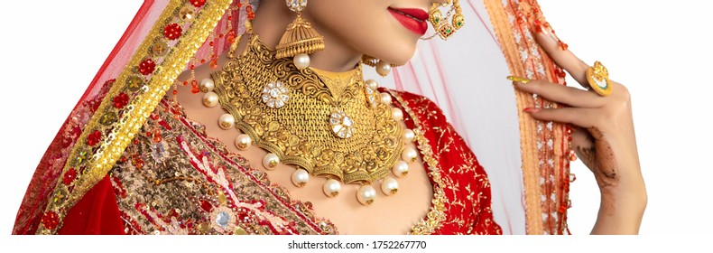 Beautiful girl with gold jewelry for woman ,necklace ,earrings and bracelet. Beauty and accessories.