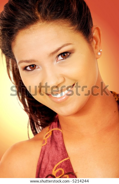 beautiful girl in golden colours smiling over a yellow and red backgrounds