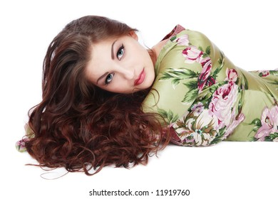 Beautiful girl with gorgeous curling hair lying on white background