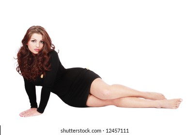 Beautiful girl with gorgeous curling hair sitting on white background