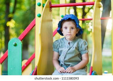 Beautiful girl in a green dress for a walk.