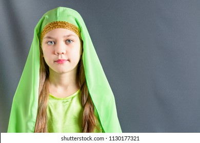 Beautiful girl in a green suit with hijab for oriental dance Nubia.