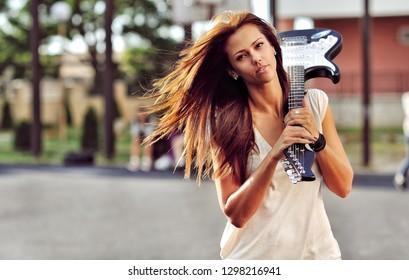 Beautiful girl with guitar - outdoor