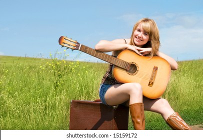 beautiful girl with a guitar outdoor