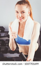 Beautiful girl at the gym exercising on trainers. Beautiful girl