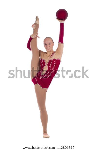 Beautiful girl gymnast with a ball and leg up over white background