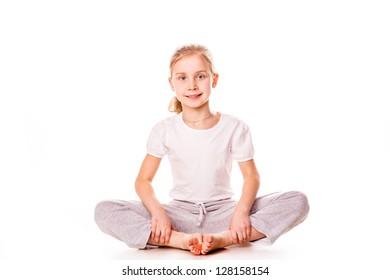 Beautiful girl gymnast  exercising, stretching isolated on white