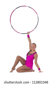 Beautiful girl gymnast with a hoop over white background