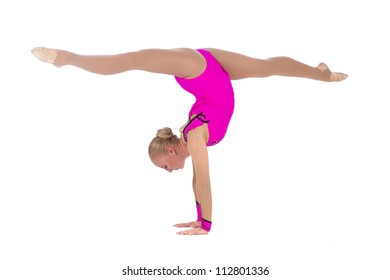 Beautiful girl gymnast staying in a handstand and doing split over white background