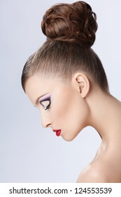 Beautiful girl with a hairstyle and make-up
