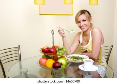 The beautiful girl has breakfast